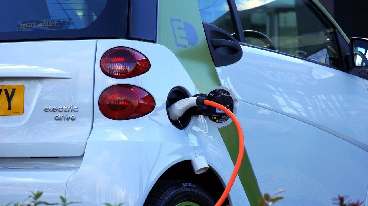 Electric vehicle at charging point - samuel barbosa da cunha